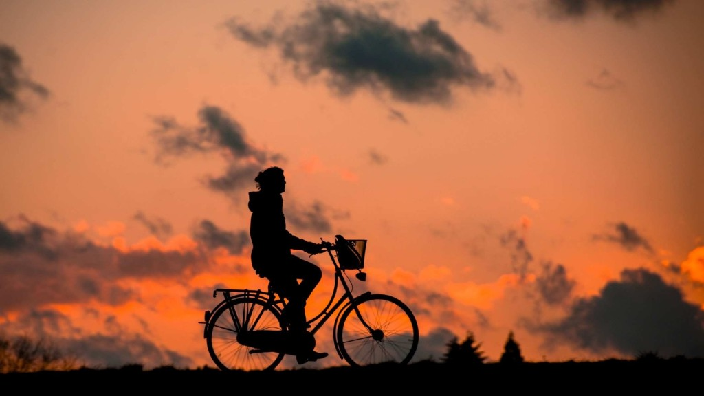 silhouette-of-person-riding-a-bike-during-sunset-37836